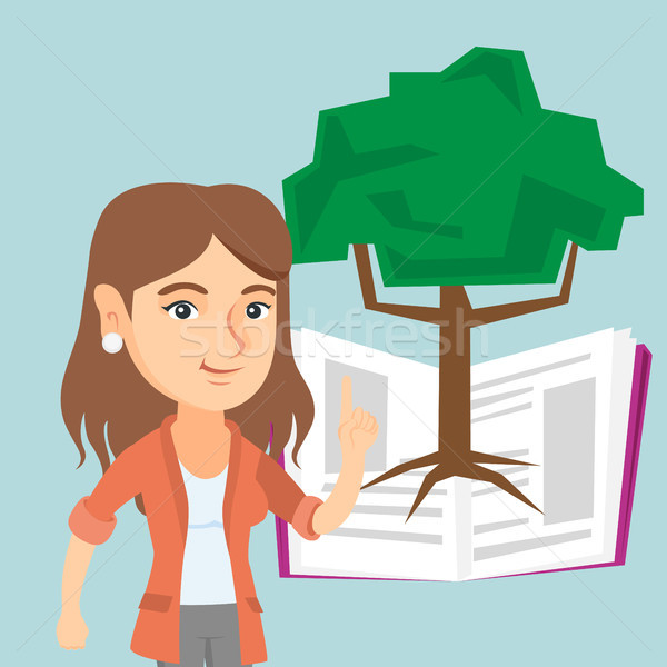 Caucasian student pointing at tree of knowledge. Stock photo © RAStudio