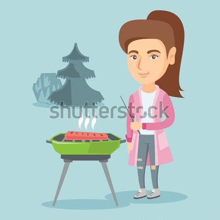 Femme cuisson steak barbecue asian extérieur Photo stock © RAStudio