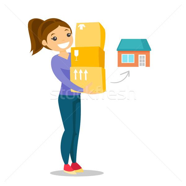 Fiatal kaukázusi fehér nő mozog új ház Stock fotó © RAStudio