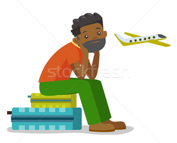 Black man suffering from fear of flying. Stock photo © RAStudio