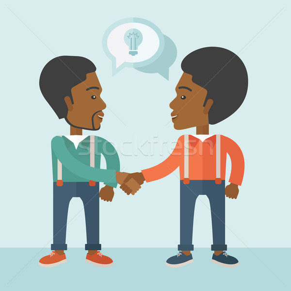 Two African-american guys happily handshaking. Stock photo © RAStudio