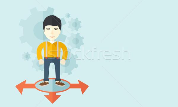 Businessman standing on three arrows. Stock photo © RAStudio