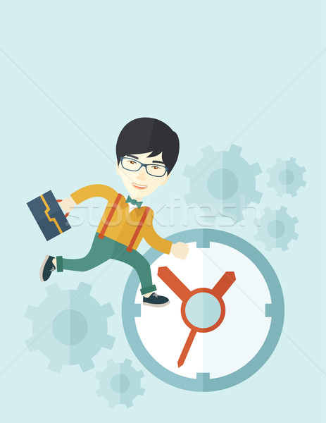 Japanese Worker with briefcase is running out of time. Stock photo © RAStudio