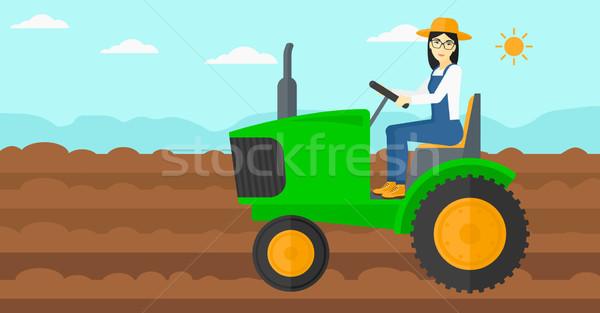 Agricultor conducción tractor Asia mujer agrícola Foto stock © RAStudio