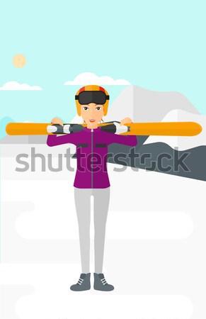Woman holding skis. Stock photo © RAStudio