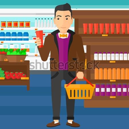 Vásárló bevásárlókosár cső krém ázsiai férfi Stock fotó © RAStudio