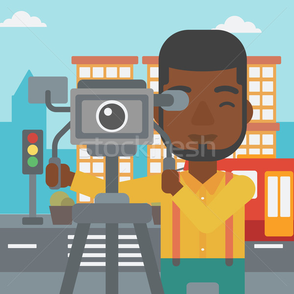 Cameraman with movie camera on a tripod. Stock photo © RAStudio