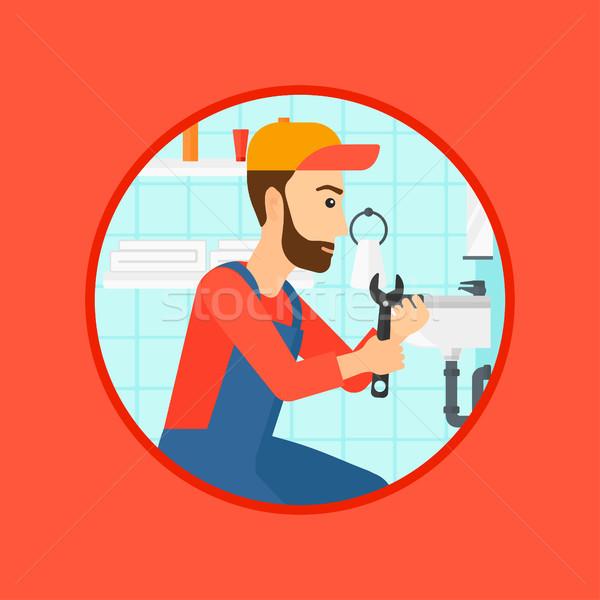 Stock fotó: Vízvezetékszerelő · megjavít · mosdókagyló · cső · franciakulcs · hipszter