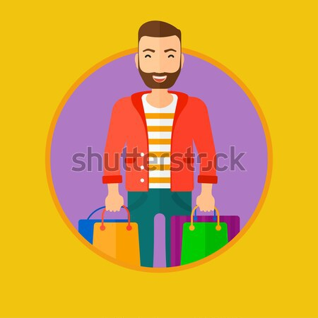 Happy man with shopping bags vector illustration. Stock photo © RAStudio