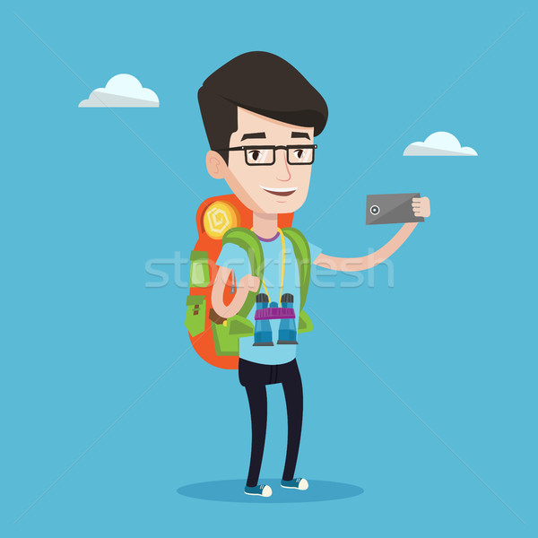 Man with backpack making selfie. Stock photo © RAStudio
