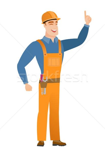 Caucasian builder pointing with his forefinger Stock photo © RAStudio