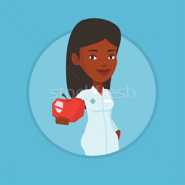 Voedingsdeskundige aanbieden vers rode appel dieet gezond eten Stockfoto © RAStudio
