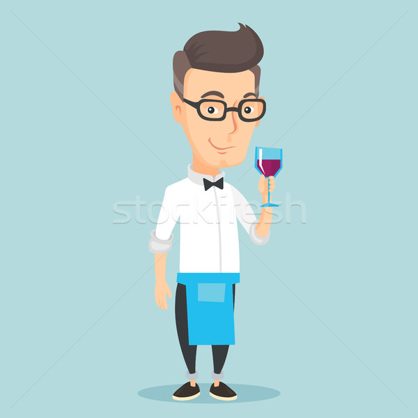 Bartender holding a glass of wine in hand. Stock photo © RAStudio