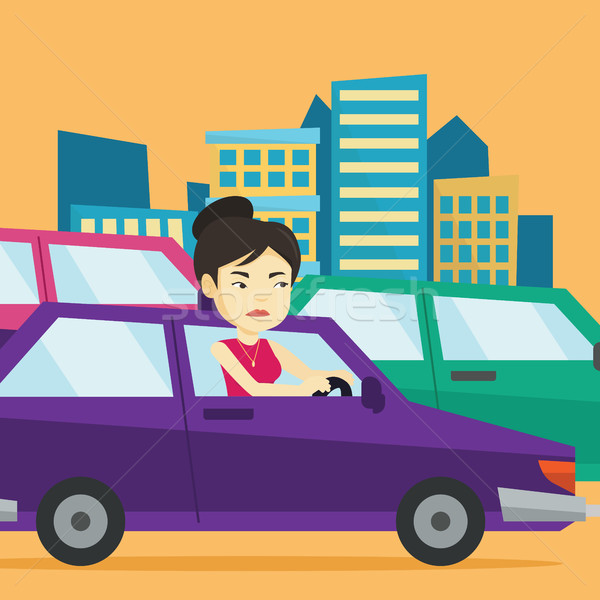 Angry asian woman in car stuck in traffic jam. Stock photo © RAStudio