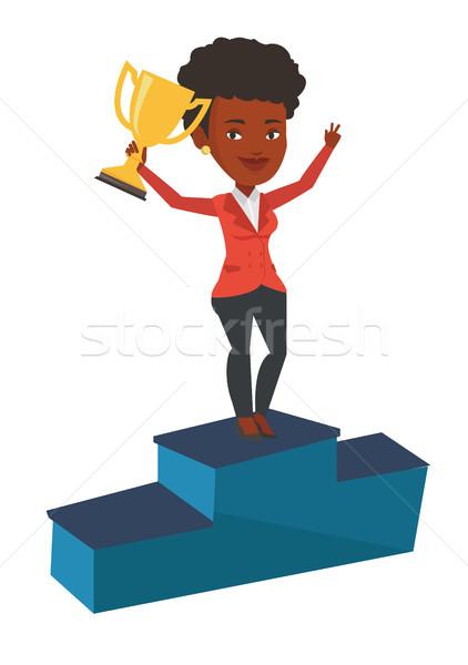 Businesswoman proud of his business award. Stock photo © RAStudio