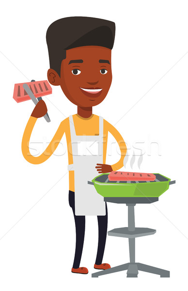 Homme cuisson steak barbecue heureux extérieur Photo stock © RAStudio