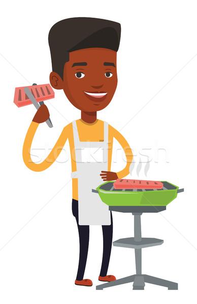 Férfi főzés steak barbecue grill boldog szabadtér Stock fotó © RAStudio