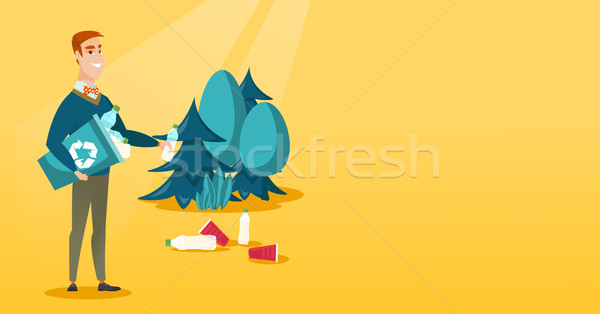 Man collecting garbage in forest. Stock photo © RAStudio