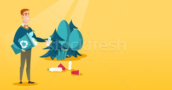 Człowiek śmieci lasu recyklingu Zdjęcia stock © RAStudio