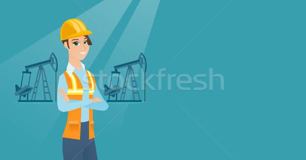 Olajmunkás kaukázusi egyenruha sisak áll karok Stock fotó © RAStudio