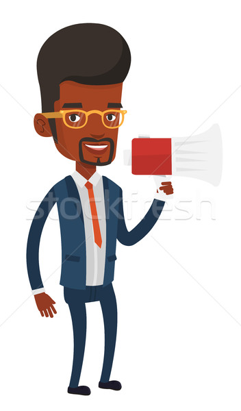 Young business man speaking into megaphone. Stock photo © RAStudio
