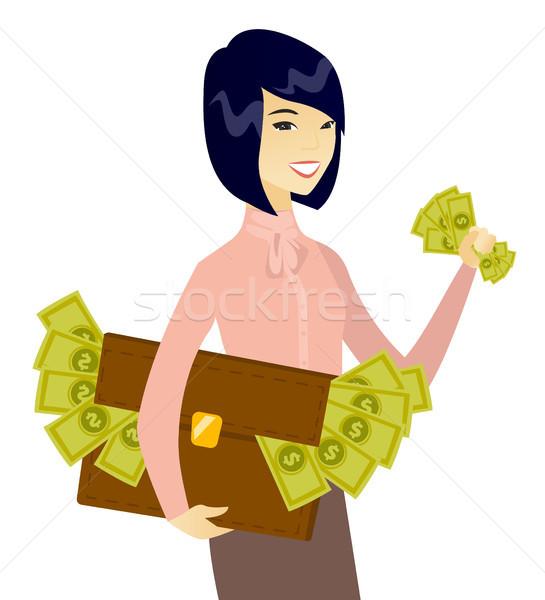 азиатских деловой женщины портфель полный деньги молодые Сток-фото © RAStudio