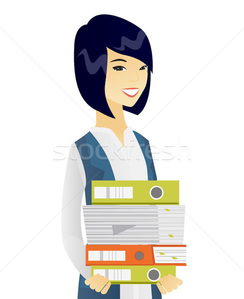 Young asian business woman holding pile of folders Stock photo © RAStudio