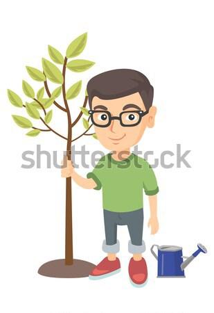 Caucasiano menino planta regador óculos Foto stock © RAStudio
