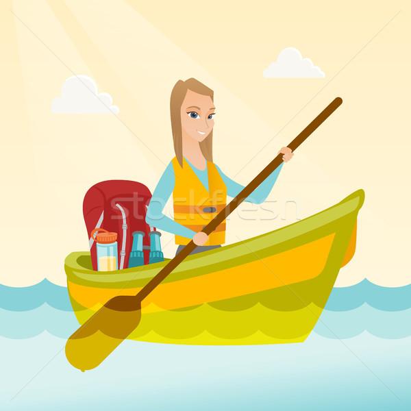 Young caucasian woman riding a kayak. Stock photo © RAStudio