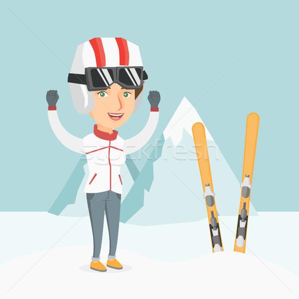 Jonge kaukasisch skiër permanente opgeheven handen bergen Stockfoto © RAStudio