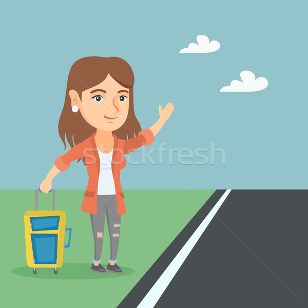 Young caucasian woman with a suitcase hitchhiking. Stock photo © RAStudio