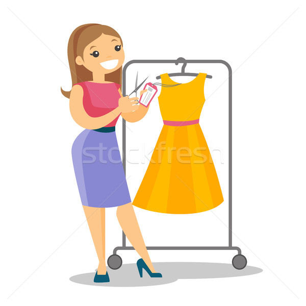 Caucasian woman cutting price tag off new dress. Stock photo © RAStudio