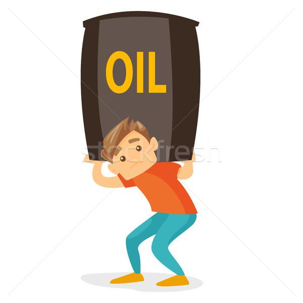 Fiatal kaukázusi fehér férfi hordoz olaj hordó Stock fotó © RAStudio