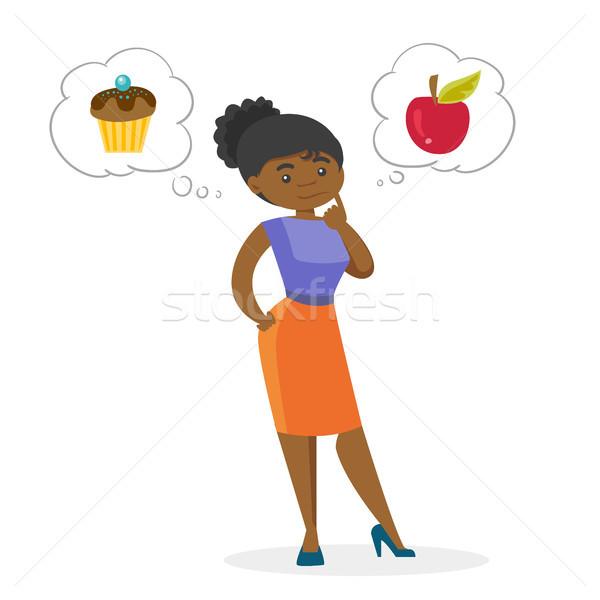 Africano mulher escolher maçã jovem Foto stock © RAStudio