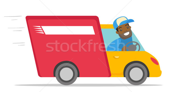 African-american courier driving a delivery truck. Stock photo © RAStudio
