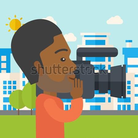 Cameraman with video camera Stock photo © RAStudio