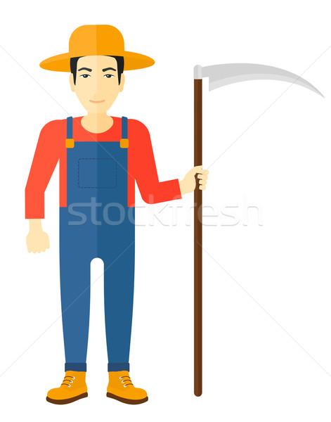 Farmer with scythe. Stock photo © RAStudio