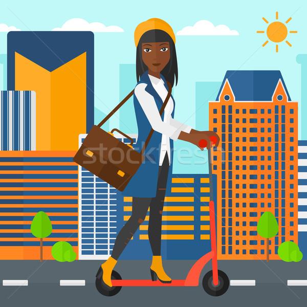 Kobieta jazda konna teczki pracy miasta Zdjęcia stock © RAStudio