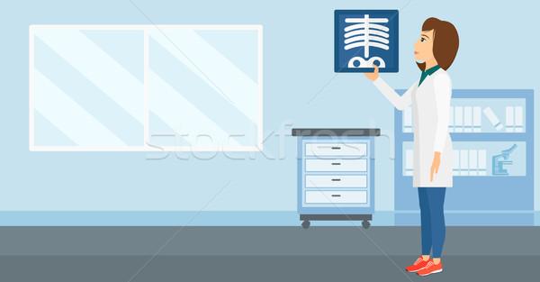 Doctor examining radiograph. Stock photo © RAStudio