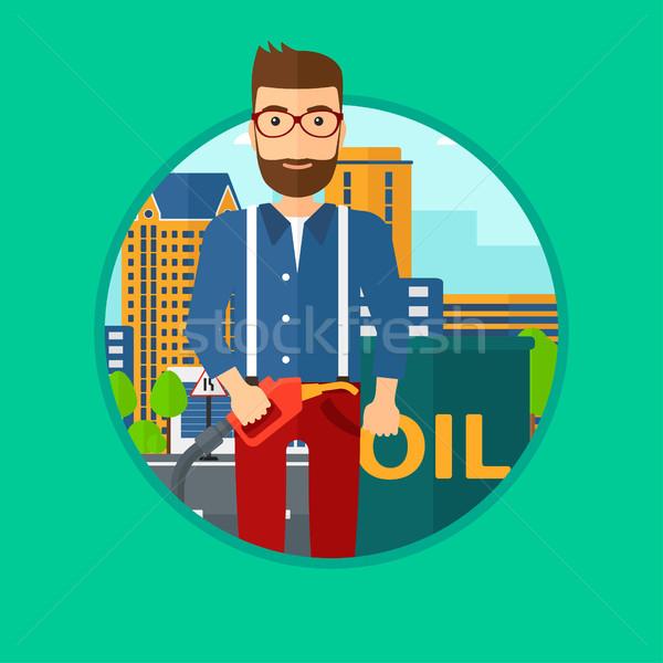 Homme pétrolières baril buse Photo stock © RAStudio