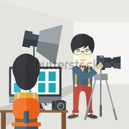 Photographer working with camera on tripod. Stock photo © RAStudio