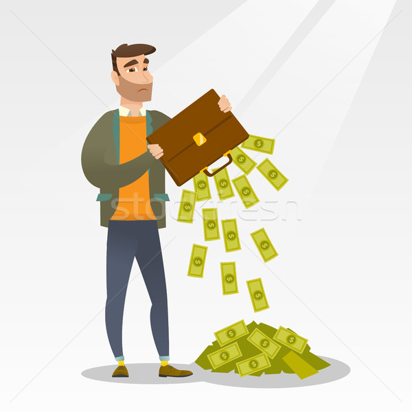 Bankrupt shaking out money from his briefcase. Stock photo © RAStudio