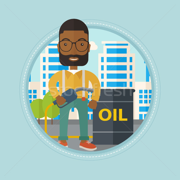 Man with oil barrel and gas pump nozzle. Stock photo © RAStudio
