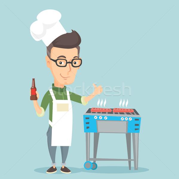 Man cooking steak on barbecue grill. Stock photo © RAStudio