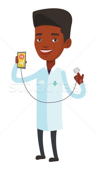 Doctor showing app for measuring heart pulse. Stock photo © RAStudio