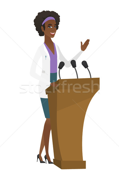 Stock photo: Doctor giving a speech from tribune.