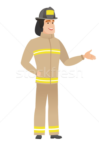 Stock photo: Firefighter with arm out in a welcoming gesture.