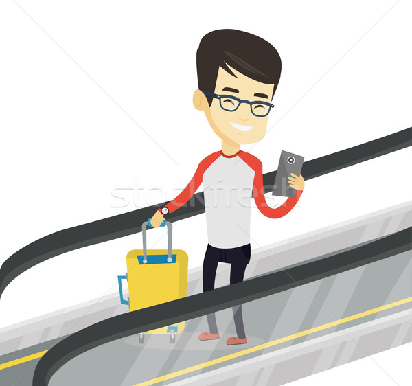 Man using smartphone on escalator in airport. Stock photo © RAStudio