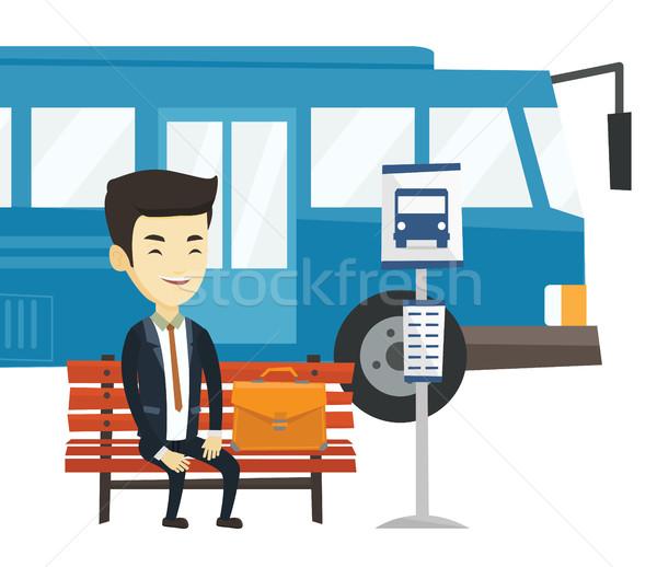 Człowiek biznesu czeka przystanek autobusowy asian młodych posiedzenia Zdjęcia stock © RAStudio