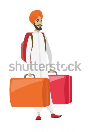 Disappointed tourist holding two big suitcases. Stock photo © RAStudio